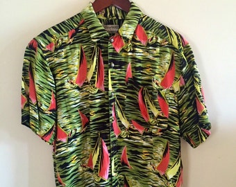 A  Rayon Hawaiian Shirt by Royal Robbins featuring sailboats and tiger stripe pattern.