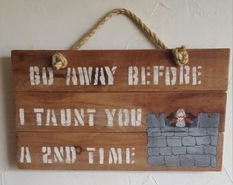 Rustic, handmade Monty Python wall hanging