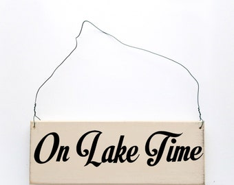 """Wood sign saying """"On Lake Time"""". Antique white wired sign."""