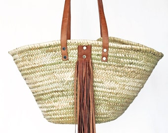 With fringes in leather wicker basket
