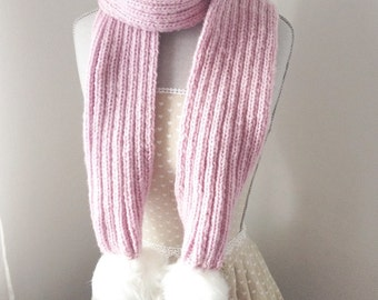 knitted pink Scarf with pom poms in white