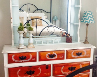 Whimsical farmhouse-style dresser with mirror.
