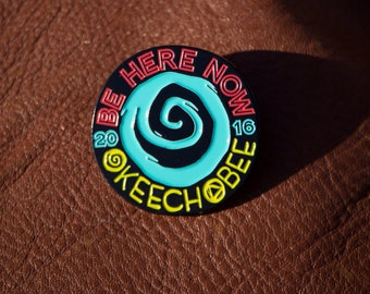 Okeechobee 'BE HERE NOW' pin