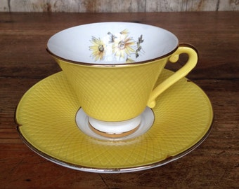 Vintage French Porcelaine Yellow Tea Cup and Saucer