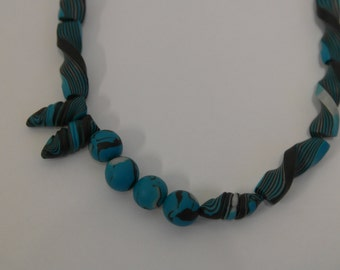 fashionable necklace made of polymer clay in turquoise, handmade
