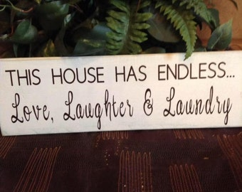 This house has endless love, laughter, & laundry - wooden sign