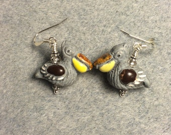 Grey, yellow and brown ceramic pelican bead earrings adorned with grey Chinese crystal beads.