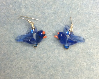 Blue bird in flight lampwork dangle earrings adorned with blue Czech glass beads.