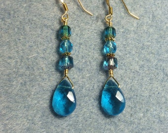 Turquoise briolette dangle earrings adorned with turquoise Czech glass beads.