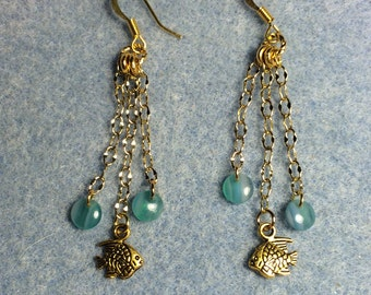 Gold fish charm dangle earrings attached to gold chain and adorned with turquoise Czech glass lentil beads.