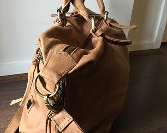 Tan leather tote. Weekend crossbody handbag. Lots of room, front pockets, fully lined with rope handles. Genuine leather tote shopping bag