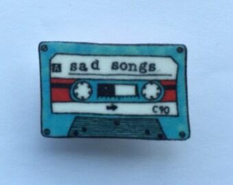Sad songs cassette badge