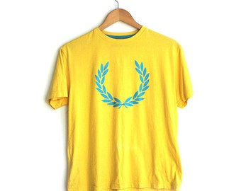 Original Fred Perry yellow t-shirt.