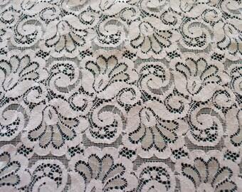 NC007, white elastic lace, 30.5cm wide. floral design, finished edges.
