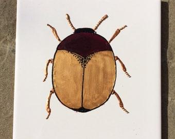 Ceramic Tile Painting, Original. Gold, purple and black bug beetle creepie crawley insect plaque