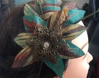 Teal Flower Burst With Bronze Charm