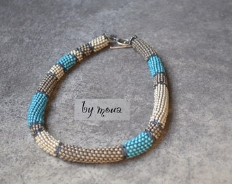 Tube necklace woven with seed beads