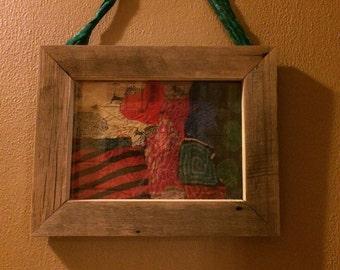 Boho picture nestled inside a barnwood frame!