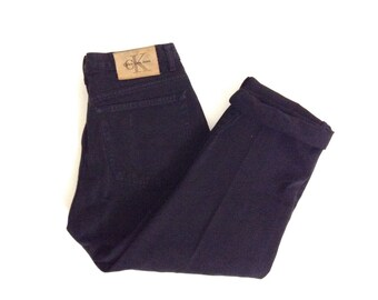 Girlfriend jeans. W26 L28. Vintage Calvin Klein 5 pkt tapered leg, cotton jeans. CK Black jeans. Made in USA