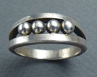 Silver ring with 4 silver balls size 10.5