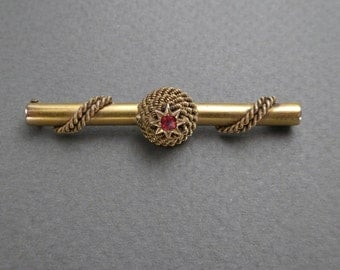 14K gold rope trim with ruby bar pin