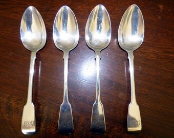 WILLIAM FOURTH SPOONS, a set of four heavy silver serving spoons  dated 1834