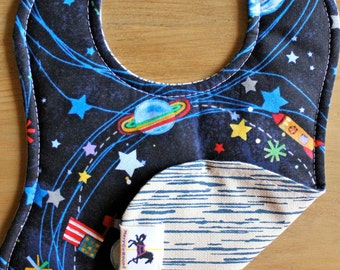 Little boy, holding an American flag, floating in outer space baby bib