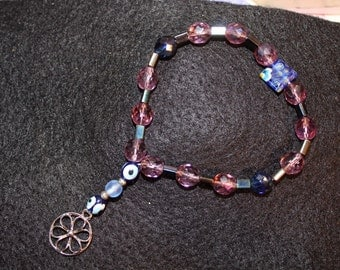 Beaded bracelet with hanging charm