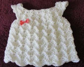 Handmade Crochet White Baby girl dress with a pink bow. Size 3-6 month.