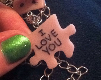 I love you puzzle piece charm.