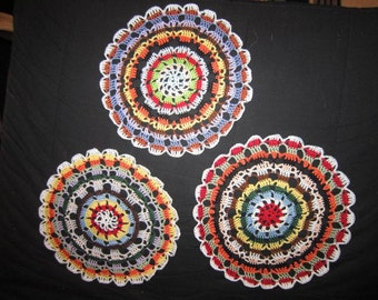3 colorful crocheted Doilies