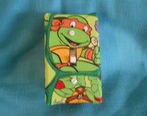 Light switch covers that are decorated with theme fabric, pictures from magazines and posters
