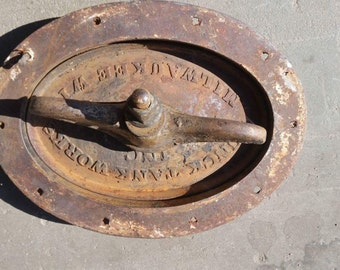 vintage cast iron tank door dunk tank works