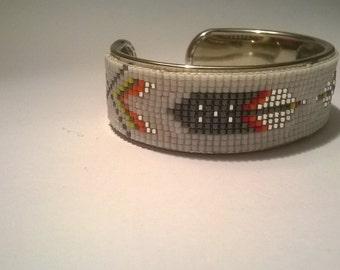 natif style narrow band on a silver metal bracelet