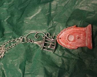 orange birdhouses necklace