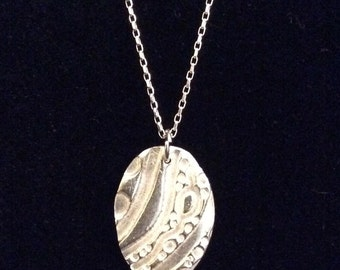 Sterling silver oval textured charm necklace
