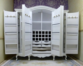 Romantic and practical wardrobe cabinet with 6 doors made in carved wood. Bespaq style.