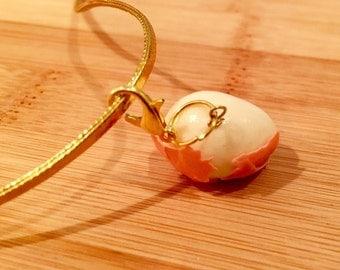 One hard boiled half peeled polymer clay egg charm