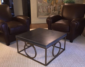 Circle steel framed coffee table with deep grey concrete top