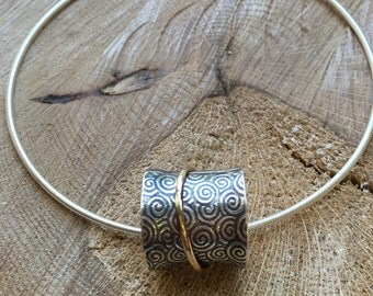 Flared Cylinder Sterling Silver Statement Pendant w/ gold filled spinner on Sterling Silver neck cable