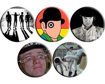 Set of FIVE A Clockwork Orange film badges (1971) handmade film / movie badge set [Stanley Kubrick, Malcolm McDowell]