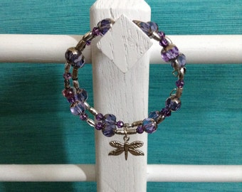 Beaded bracelet with dragonfly charm