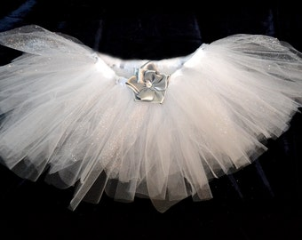 white and sylver tutu with sylver flower