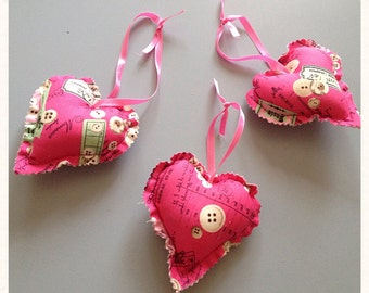 A set of 3 hanging pink hearts