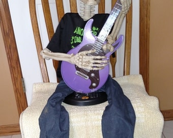 Rock guitar playing skeleton another one bites the dust