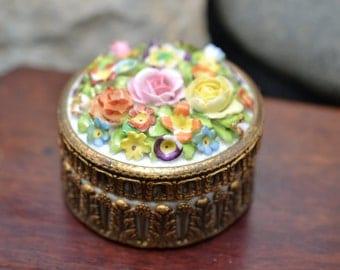 Dresden Flower Topped Porcelain Powder or Trinket Box with Ormulu Embelished Base.