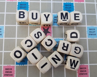 Lot of 16 Boggle cubes taken from a 1980 set.