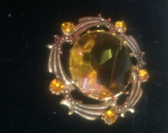 Amber colour costume brooch