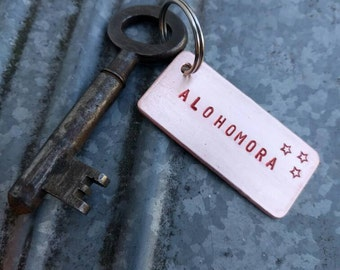 Hand made Alohomora Harry Potter keychain of copper-aluminum, stars and red-black letters, hammered back and old key