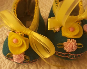 Turquoise Baby Booties with Yellow and Pink Accents